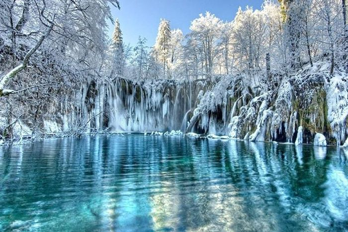 Plitvice National Park winter - Frozen waterfalls and snow in Croatia