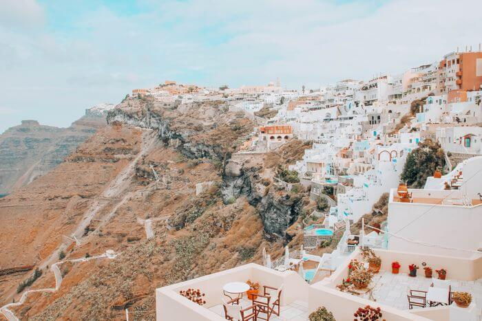Fira with a toddler in Santorini viewpoint